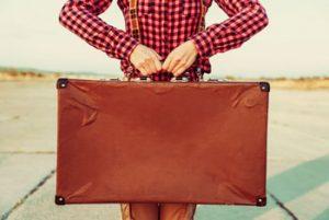 expatrié avec valise